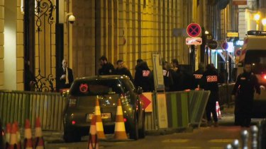 French police attend the scene outside the Ritz in Paris after a robbery Wednesday evening.