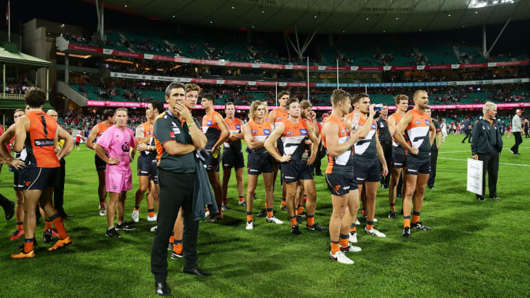 Food for thought: GWS coach Leon Cameron and Giants players after the loss to the Swans at the SCG.