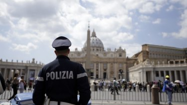 A police officer patrols outside St Peter's Square in the Vatican, Rome. Islamic extremists suspected in a bomb attack in a Pakistani market that killed more than 100 people had also planned an attack against the Vatican in 2010 that was never carried out, an Italian prosecutor said on Friday.