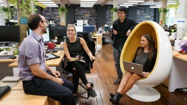 From left: Yianni Conomos (Co founder), Ellie Gray (marketing), Chester Lin and Jessica Wilson (founder CEO) of the company Stashd App, work out of the Fishburners startup hub. The startup hub provides spaces and support for new tech businesses.