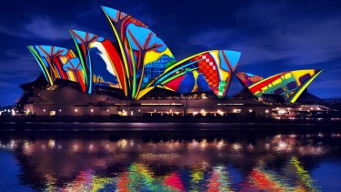A scene from Songlines, for the 2016 Lighting of the Sails, featuring the art of Karla Dickens.