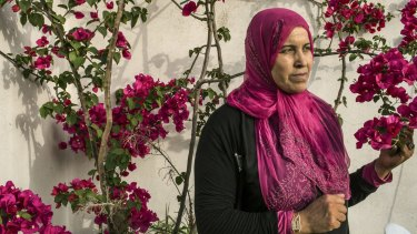 Hamida Ajengui, who was just 21 when she was arrested and beaten by Tunisia's state police, in the front yard of her home in Tunis in 2015.