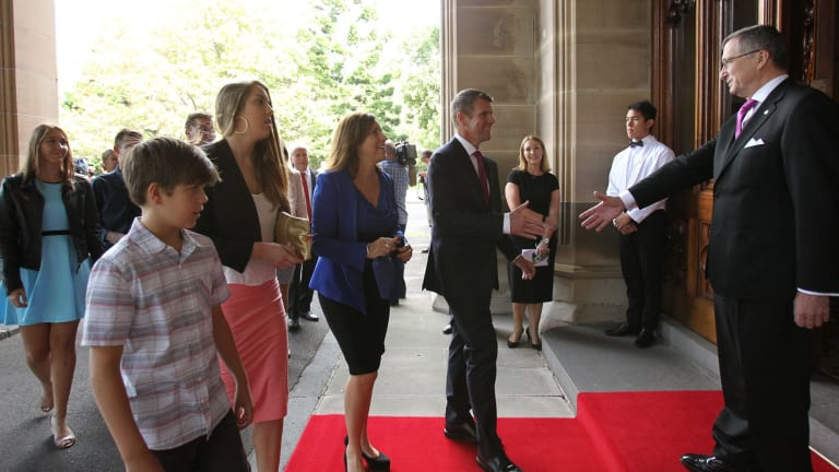 Premier Mike Baird arrives at Government House with his family.
