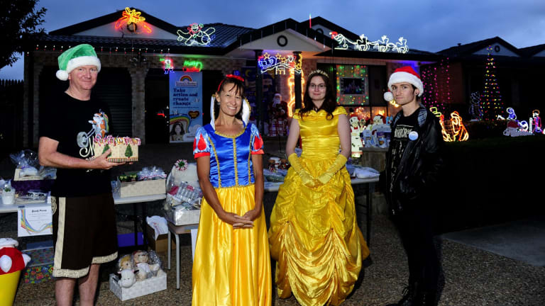 The Anthoney family of Gungahlin. From left, Stephen, Yvonne, Nalani, 21, and Jarrett, 20, with their Christmas lights display.