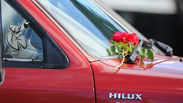 A rose was left on a 4WD at the front of the home.