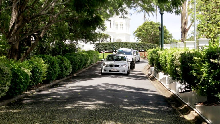 Queensland Premier Campbell Newman leaves Government House after calling an election. .