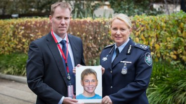 International Missing Children's Day family spokesperson Michael Macintosh, in Canberra with an age-progressed photograph of his missing son Mathieu-Pierre Macintosh, who would now be 13, with Australian Federal Police Assistant Commissioner Debbie Platz, National Manager Crime Operations.