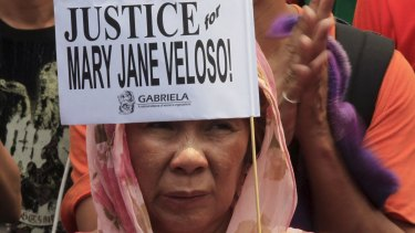 A protester holds a placard calling for justice for Filipina drug convict Mary Jane Veloso during a protest outside the presidential palace in Manila on Wednesday.
