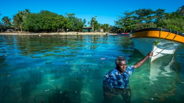 Jackson Kiloe, the Premier of Taro in the Solomon Islands, standing where the shoreline used to be.