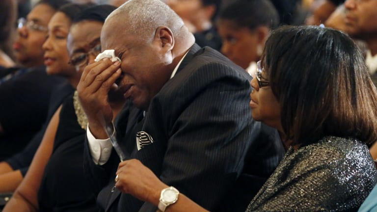 A mourner cries at the funeral of blues legend BB King.