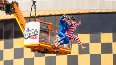 Nathan Hindmarsh and Bryan Fletcher jump from a crane onto a 'blob' floating in Darling Harbour for a world record attempt with Nitro Circus star Ethan Roberts.