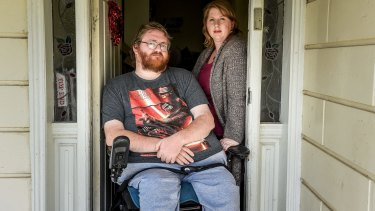 Shane Barnbrook, with wife Sarah, is suing two hospitals for negligent care that left him a quadriplegic.
