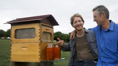 Toast of the internet: Father and son Stuart and Cedar Anderson with their invention, the 'flow hive'.