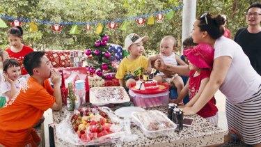 Kim Gago's extended family celebrating an early Christmas in November.