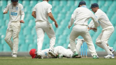 Hughes falls face down on the pitch.