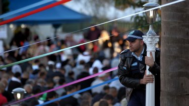 Danny Mikati looks over the crowds outside Lakemba Mosque as they gather for Ramadan prayers in 2012.
