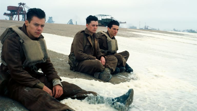 (From left) Harry Styles, Aneurin Barnard and Fionn Whitehead as young soldiers on the beaches of Dunkirk.