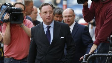 Former <i>News of the World</i> chief reporter Neville Thurlbeck arrives for sentencing at the Old Bailey in 2014.