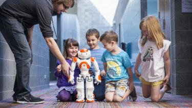 Neo Robot children for Robotronica Nao robot and children, with PhD student Gavin Suddrey.