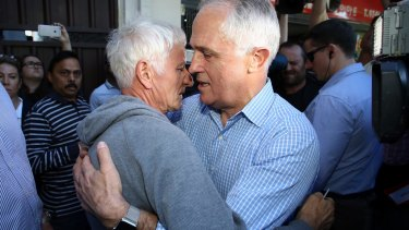 'This was a dad grieving for his son':  Malcolm Turnbull embraces Serge Oreshkin.