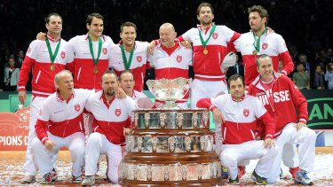 Centre of attention: Australian David Macpherson (centre), with members of the victorious Swiss Davis Cup team.