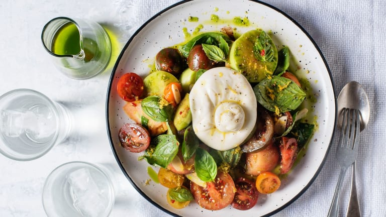 Heirloom tomatoes with burrata and basil oil.