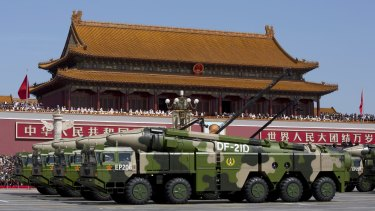 Chinese military vehicles carrying DF-21D anti-ship ballistic missiles, potentially capable of sinking a US Nimitz-class aircraft carrier in a single strike, drive past Tiananmen Gate on Thursday.