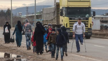 Syrians fleeing a government offensive and Russian air strikes try to cross the border into Turkey  this month.