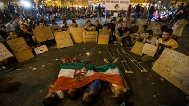 Migrant children sleep under a Hungarian flag in front of Keleti station in central Budapest on Wednesday.