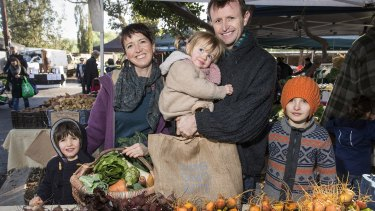 Lauren Dircks and Andrew Casey shopping at the Abbotsford Convent farmers market in Melbourne with their children, Gus 5, Emiliana 2 and Owen 9.