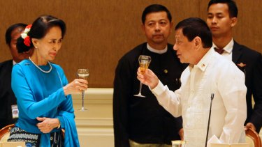 Aung San Suu Kyi, left, offers a toast to Philippine President Rodrigo Duterte, right, in Naypyitaw, Myanmar, last week.