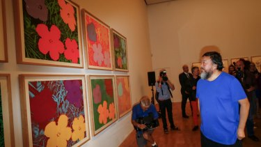 Ai Weiwei views Andy Warhol's 1970 Flowers screenprint at the NGV.