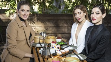Kate Waterhouse has lunch with Lisa (in white) and Jessica Origlias - the Veronicas.