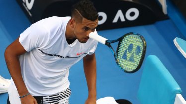 Kyrgios throws his racquet during his second-round loss to Andreas Seppi in Melbourne on Wednesday.