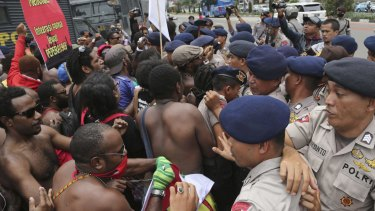 Activists scuffle with police during a rally marking the 53rd anniversary of the Free Papua Movement in Jakarta on December 1.