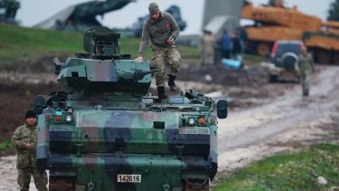 Turkish troops prepare their tanks to enter combat in Afrin, Syria.
