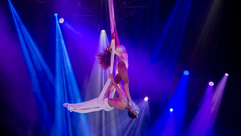 Daria Shelest and Vadym Pankevyvh perform in Le Noir - The Dark Side of Cirque.