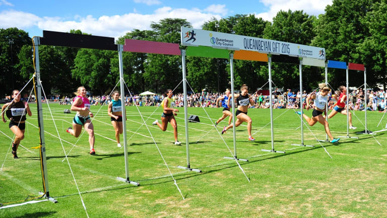 Sophie Broadhead, in white, wins the 120m women's Queanbeyan Gift.
