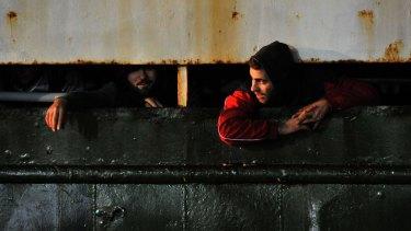 Syrian migrants arrive in the Italian port of Corigliano aboard a rusty ship.