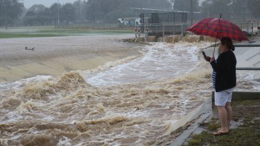 The storm water drain near Dickson oval was overflowing on Sunday morning.