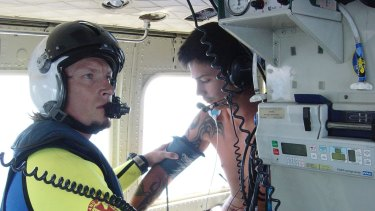 A 20-year-old man receives care aboard an RACQ Careflight helicopter after being bitten by a shark while on a tuna boat 100 nautical miles off Coolangatta.