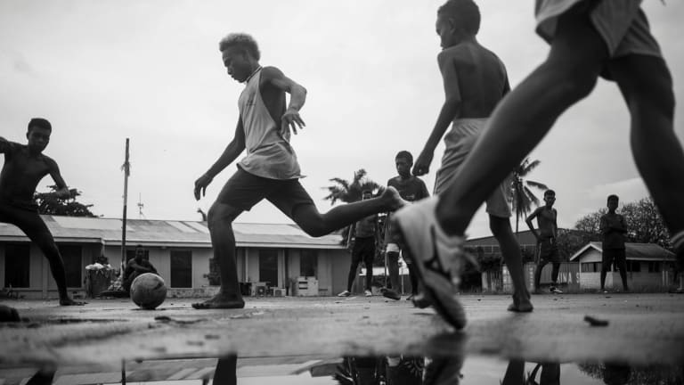 Sean Davey, Boys play a game of park soccer in Honiara, 2017, in Next Generation: Solomon Islands After RAMSI at Photoaccess.