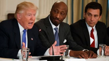 Trump, left,meeting with manufacturing executives in February, including Kenneth Frazier, centre.
