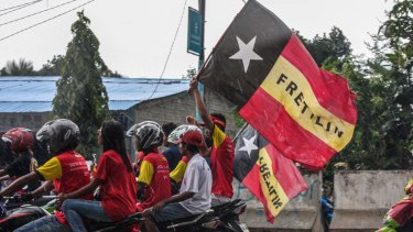 Supporters of Fretilin, the country's largest political party, on the streets of Dili.