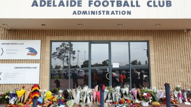 Tributes to the late Adelaide coach outside AAMI stadium.