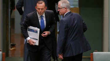 There is a push for Tony Abbott, left, to be reinstated in Malcolm Turnbull's Cabinet.