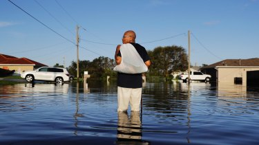 Jean Chatelier walks through a flooded street from Hurricane Irma in Fort Myers, Florida.