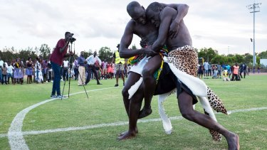 Wrestlers grapple for a cause in Sydney's west.