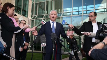 Communications Minister Malcolm Turnbull arrives to address the media and announce that he is challenging Prime Minister Tony Abbott for the leadership.