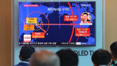 People watch a TV news program reporting a North Korea's missile launch, at the Seoul Railway Station in South Korea.